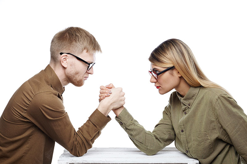 two people arm wresting content VS SEO
